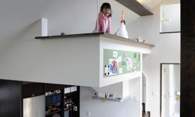 子世帯のロフト|ふたつの家族と中庭の家
