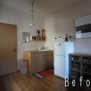 ローコストリノベーション  無機質空間から木質空間への写真 Before 作業台をキッチンに変更
