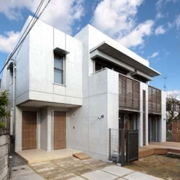 ワークスペースのある二世帯住宅 (コンクリート打ち放しの外観)