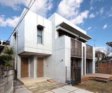 ワークスペースのある二世帯住宅の部屋 コンクリート打ち放しの外観