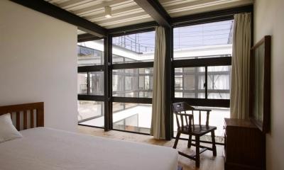 『I・M邸』光を共有する二世帯住宅 (子世帯-開放的なベッドルーム)