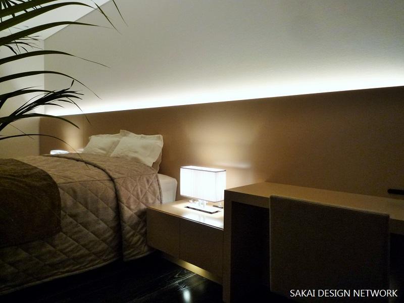 「ザ六本木TOKYOクラブレジデンス」ゲストハウスの写真 ブラウン基調のベッドルーム