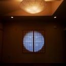 丸窓がアクセントの和室-2