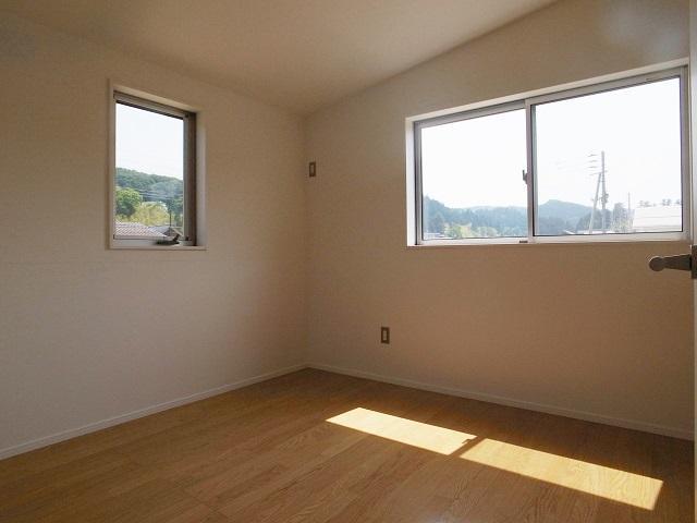 『八幡の家』シンプルナチュラルな住まいの部屋 シンプルナチュラルな寝室
