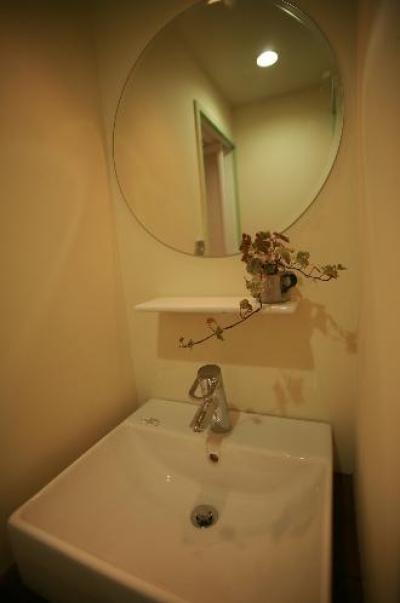 丸鏡の洗面所 (S-APARTMENT(リノベーション))