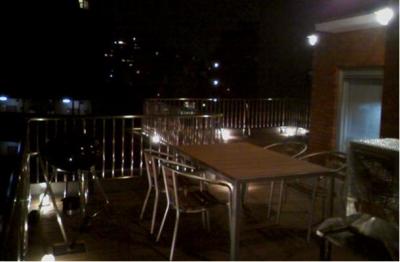 夜景を楽しめるバルコニー (素材や設備を吟味した高級シンプルモダン空間)