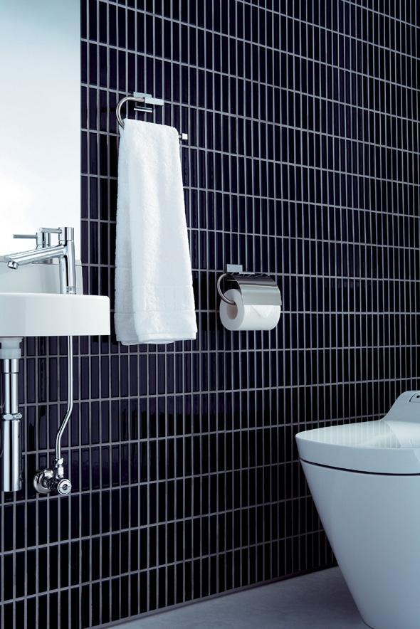 アーバンスタイルの部屋 タイル張りのトイレ