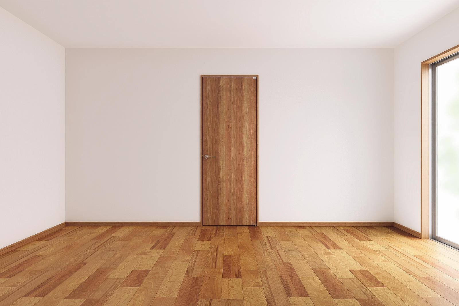 カントリーテイストの部屋 木を感じるベッドルームのドア